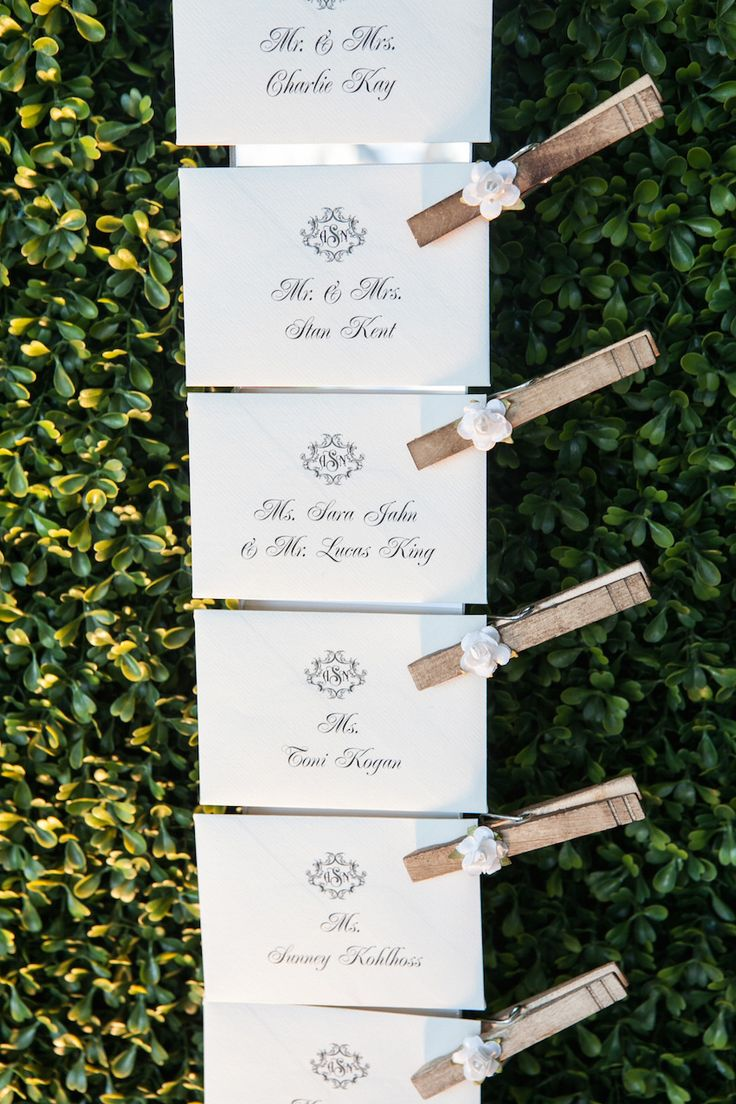 wedding table name card size%0A Escort cards clothespin on hedge