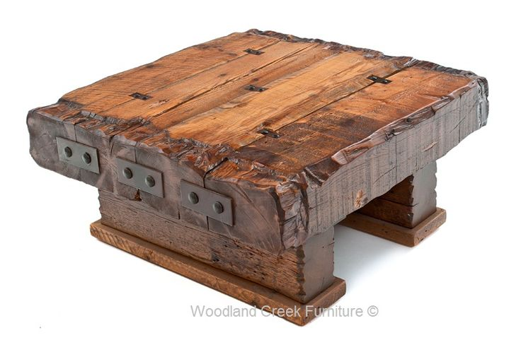 """This is a one of a kind piece. Only a few each year will be available. Reclaimed barnwood beams are used to create a thick, massive coffee table. You can specify the height you would like. It may not look as tall in the photo, but the one in the first photo is actually 19"""""""