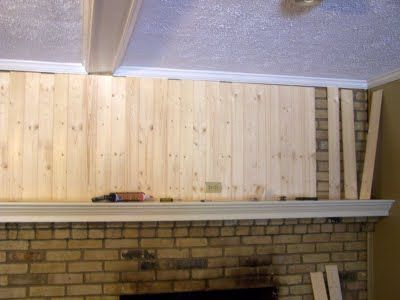 Cover An Ugly Brick Fireplace With Wood, Vertically. Add Some Trim. Paint It