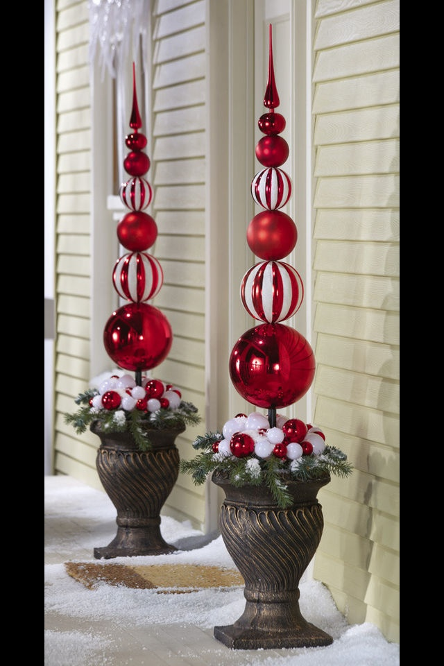 """Create that Christmas wonderland when you display this 45"""" red and white finial inside the decorative urn (sold separately). 6 graduated-in-size balls topped with a red finial gives this an elegant appeal.  Made out of Plastic, wire.  Measures 8""""Dia. x 45""""H"""