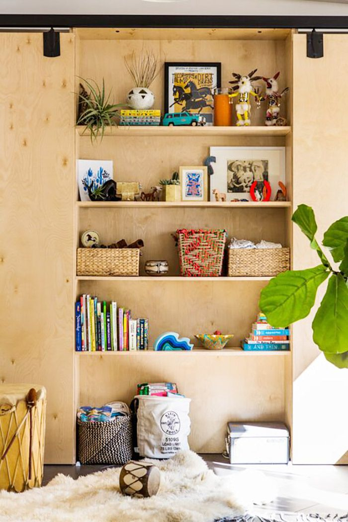 Bookshelf with kid toys and fiddle leaf