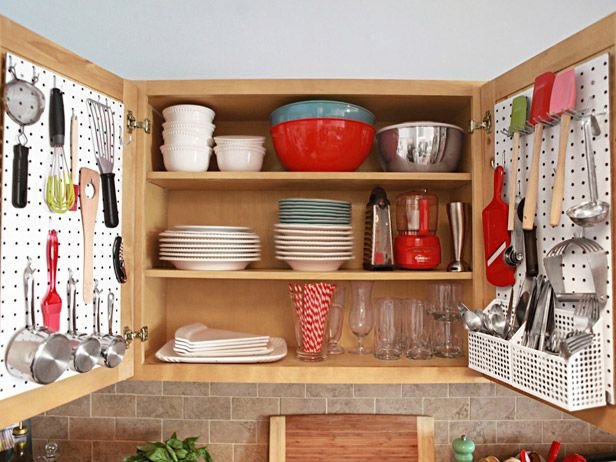 "a ""Neat"" way to be organized in a small kitchen!! love it..... I like the idea of utilizing your cabinets to the fullest extent I can clear out some of my drawer space"