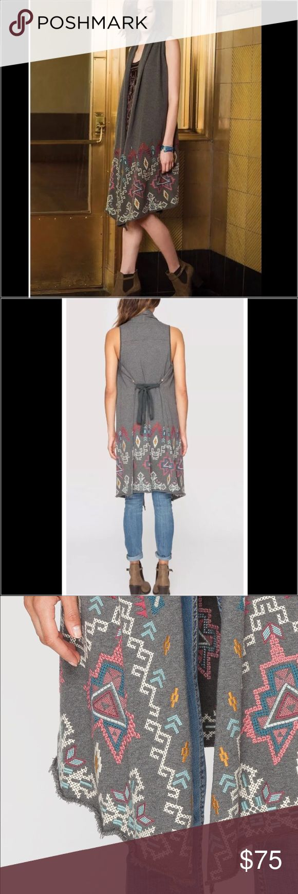 JWLA Tisha Drape Vest Navy Blue EUC. The TISHA VEST is a unique layering piece! This cotton vest features colorful Aztec-inspired embroidery along the hem, and a tie that can be worn around the waist or in the back. Layer over jeans and a tee to add boho flair to your casual look! * The one I am selling is navy blue… The die is slightly inconsistent, appears to be somewhat Sunwashed, but I purchased it like that, and does not distract from the beauty of the garment. - Open Front, Sleeveless…