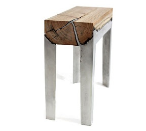 Molten aluminum cast directly onto split log sections to make one of the most original pieces of furniture I've seen in a while.