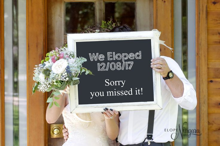 Fun chalkboard signs at The Little Log Wedding Chapel in Niagara