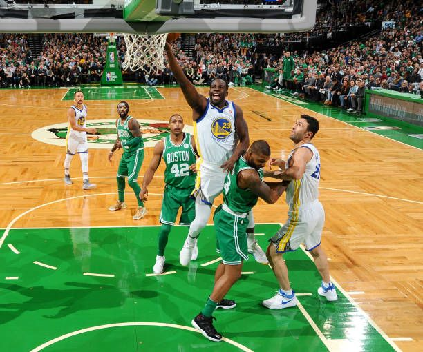 Draymond Green of the Golden State Warriors goes to the basket against the Boston Celtics on November 16 2017 at the TD Garden in Boston...