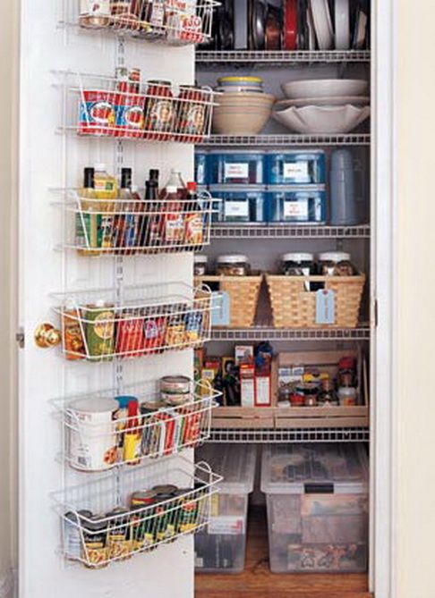 Pantry organization - I like the rack mounted on the inside of the door. That way you don't see the 'over the door hangers' popping out on the outside.