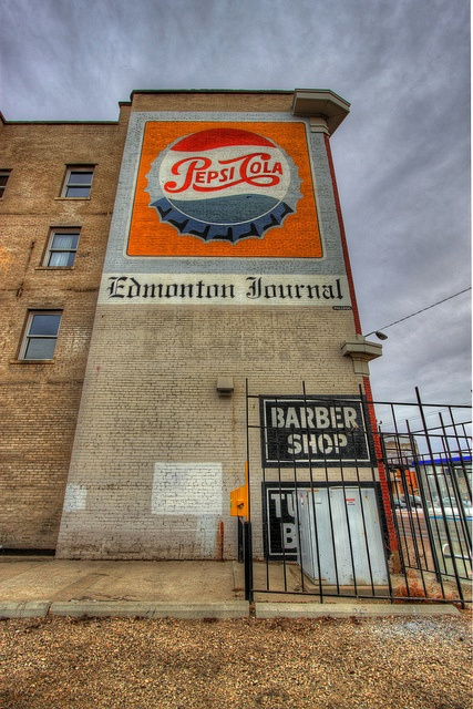 Old-timey Pepsi and Edmonton Journal building art.