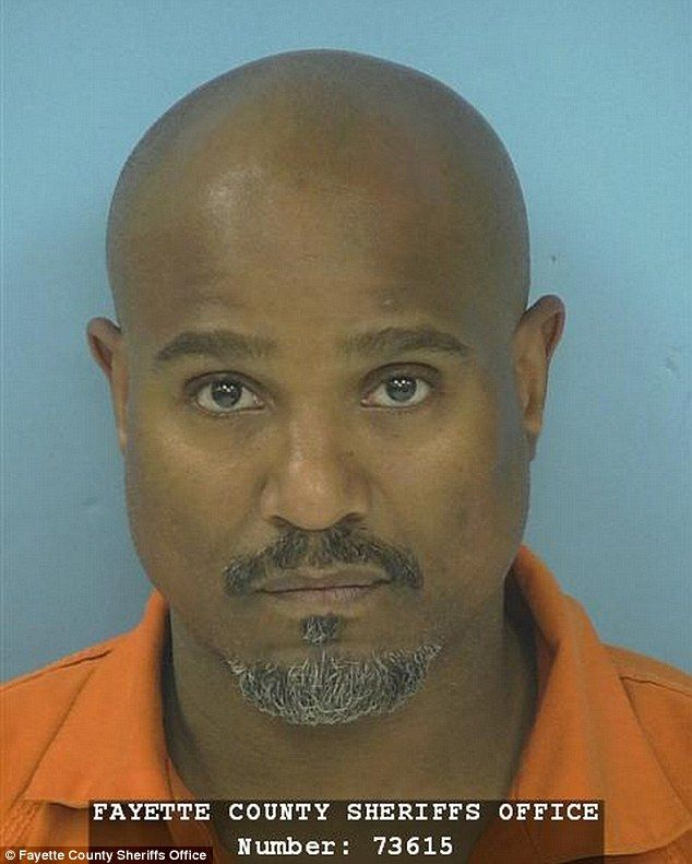 Trouble with the law: Seth Gilliam from The Walking Dead was arrested early on Sunday morning while driving in Georgia; here he is seen in his mug shot from the Fayette County Sheriff's Office