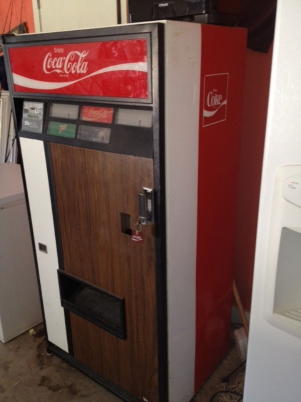 Old school soda machine. We used to have one in the Fellowship Hall/kitchen at church! Haaaa! I love it!