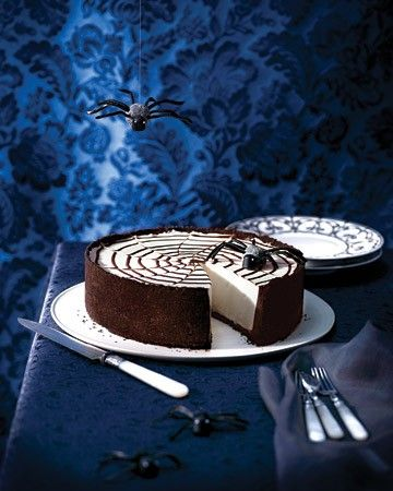 Innocents are snared easily by a ganache spider-web. Spun by a gumdrop spider with limber licorice-string legs, the web is draped over a dangerously addictive and creamy no-bake cheesecake.