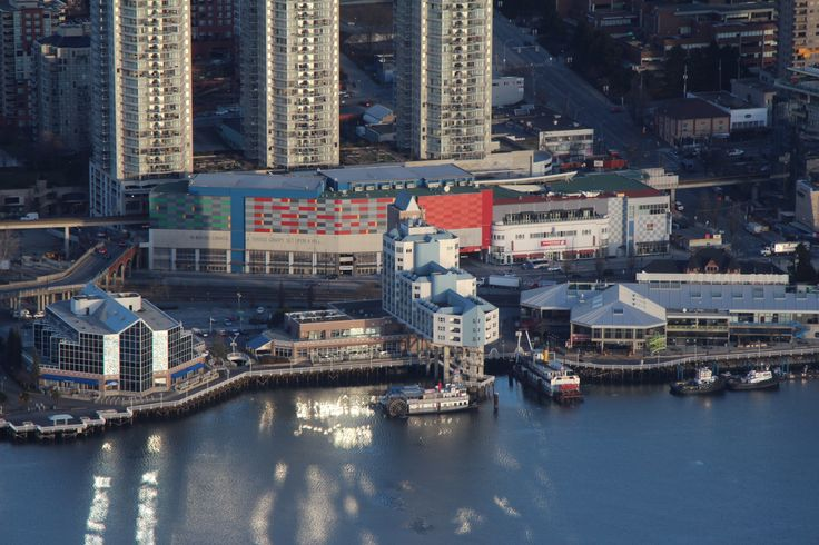 Aerial shot over the Inn At The Quay Hotel showcasing the River Market and New Westminster Station one of the five SkyTrain stops in the city