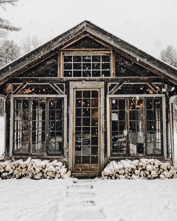 Weathered winter cabin standing among the snow