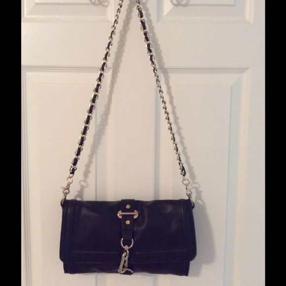 Melie Bianco Black Gold Chain Shoulder Bag Gold hardware. Bag has a main zip closure.  3 compartments (middle zips).  3 interior pockets (1 zips). Lobster claw closure.  Great condition.  Man made.  Measures: 11.5x1x7.5x17.5. Melie Bianco Bags Crossbody Bags
