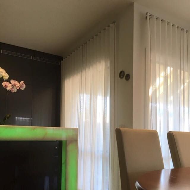 Translucent softly layered window treatments are ideal for modern homes. These s fold continuous sheer curtains bring ample light and accentuate the features in the room.