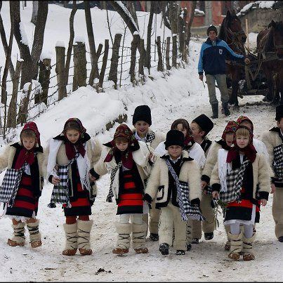 at Christmas, in many villages in Romania children dress in traditional clothes and sing carols