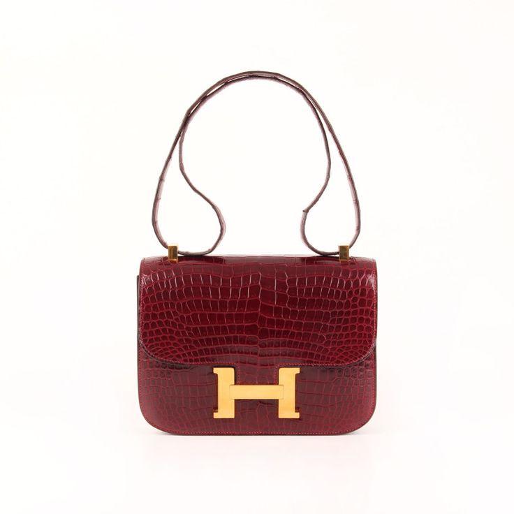 Hermès Constance MM 23 in Dark Raspberry Porosus Crocodile leather.