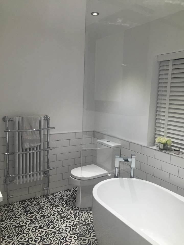 The neutral colour in this white bathroom provides the perfect backdrop for those gorgeous 'boho' patterned bathroom floor tiles.