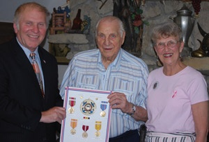 U.S. Representative Steve Chabot (R-OH) presented Colerain Township resident and former trustee Ralph Sandoz, center, with medals he earned while a member of the Office of Strategic Services (OSS) during World War II. Sandoz's wife Betty helped arrange the medal ceremony. Brother Sandoz is a 63-year member of Local 18 Ohio. (Year: 2011)