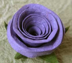 Rose made from handmade paper. Instructions at http://www.bellaonline.com/articles/art12218.asp
