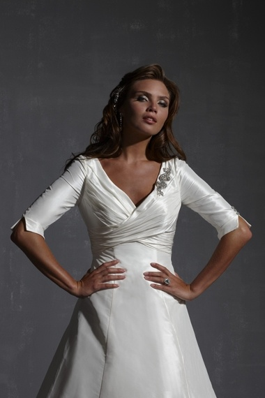 Classic A-line wedding dress with deep v-neck and half length sleeves design. Taffeta is ruched across the bodice plunging into wrapped waist. Keyhole back. Free made-to-measurement service for any size. Available colors seen as in Color Options.