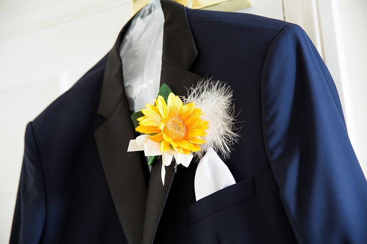 Groom suit with silk yellow flower buttonhole Surrey wedding © Fiona Kelly Photography