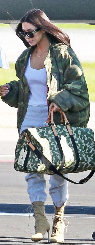 Kim Kardashian in Coat – Raf Simmons  Bag – Louis Vuitton  Shoes – Yeezy  Sunglasses – Celine