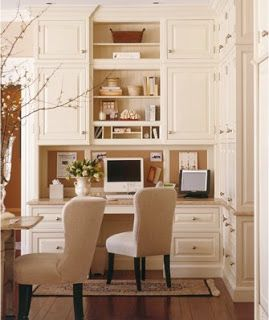 desk area in kitchen keeps desk clutter out of sight and uses chair from the kitchen table nice for space challenged house