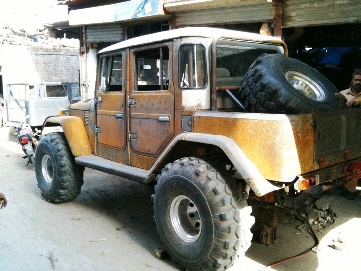 FJ45 crew cab shorty. Pretty sure there was no production units like this. Great custom, haul the whole family and gear. Head for the mountains.