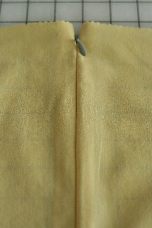 Just used this tutorial to sew an invisible zipper for the first time, it worked perfectly