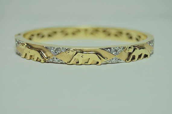 This is a beautiful and unique piece, perfect for handing down generation to generation. Its elegance, and class is timeless with three graceful panthers adorned with twenty-four diamonds on the front. The details dont stop there, with the gold on the back cast in geometric angles, and even a filigree pattern cut into the inside of the band. This solid gold bangle is not just a piece of jewelry, it is a work of art, perfect for an heirloom piece. It is normally $4799.99 in our store. But is…