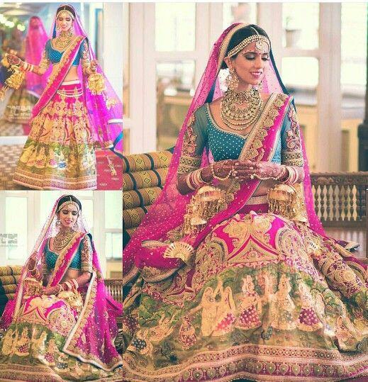 Bridal lehenga by Neeta Lulla. Peacock blue blouse, pink, green and dull gold colours. Image via @nishkalulla Instagram