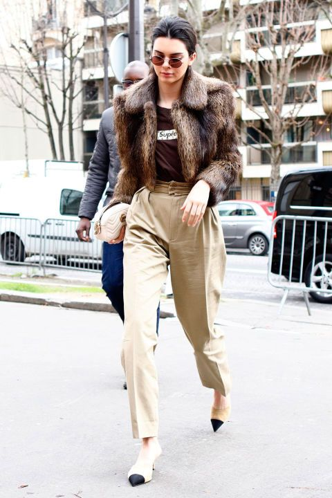 March 2017Kendall Jenner arrivedat the Miu Miu show during Paris Fashion Weekwearing a cropped fur jacket with a Supreme T-shirt and tailored trousers.