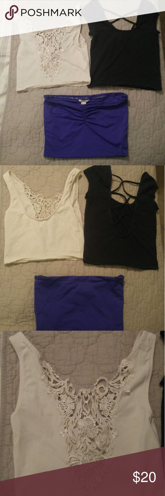 Three Crop Tops Size Small One purple crop top, one cream lacey crop top, one black strappy crop top Tops Crop Tops