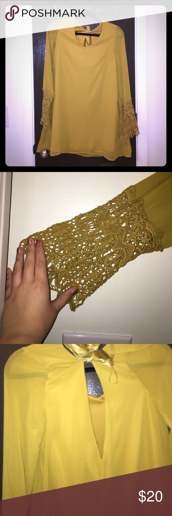 Mini mustard colored dress! This beautiful mustard colored dress is able to be dressed up or dressed down! It has such beautiful lace detailing on the sleeves and has a keyhole back with a velvet bow! Size small. Never worn umgee Dresses Mini