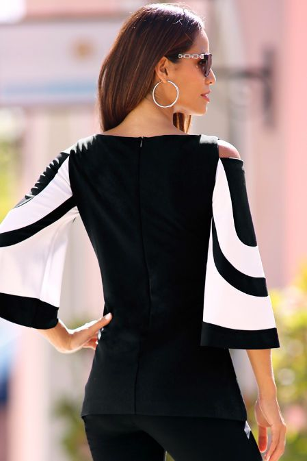 What your travel collection needs is bold colorblock style from our flare-sleeve knit top with sexy shoulder cutouts in your favorite wrinkle-resistant fabric. Hidden back zip