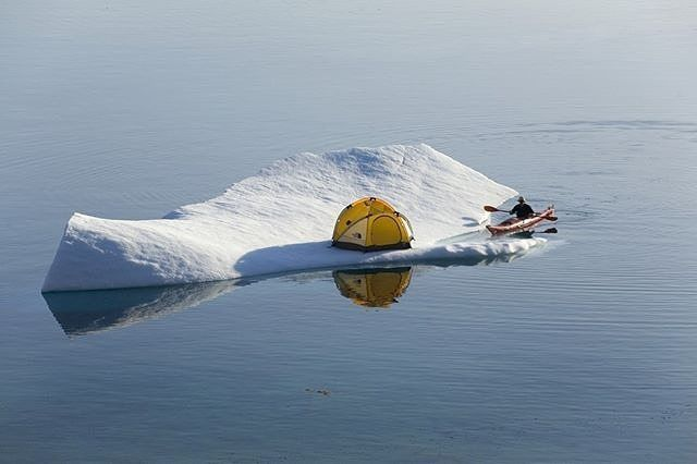 Middle of nowhere, Greenland  What are your camping plans this summer? @Glenn Mattsing is living life on the wild side on this iceberg.  Just tricking, its staged, but looks like a bloody fun time. Who's in? #travelintoliving