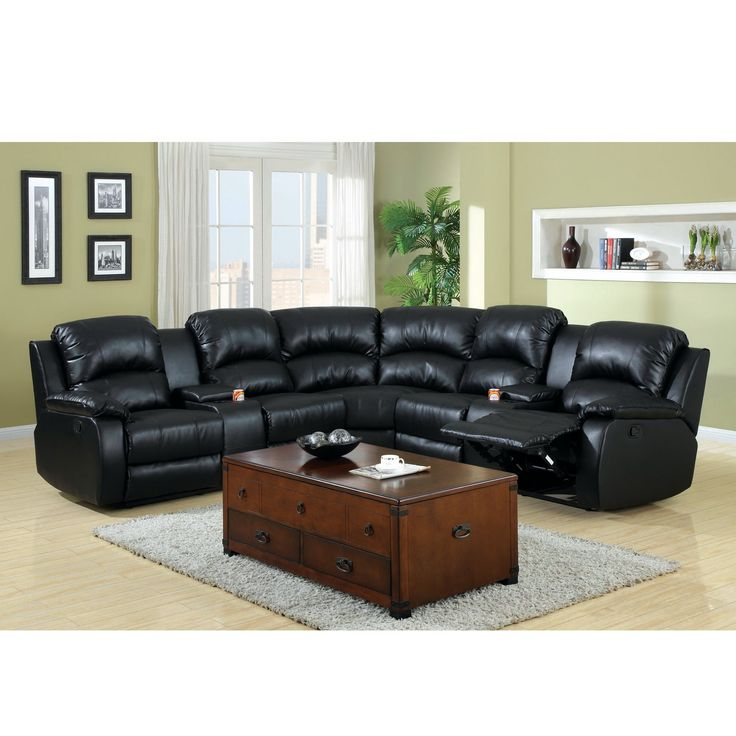 This sleek black sectional is perfect for the family room or living room. With extraordinary comfort of bonded leather, this sofa features duo recliners and cup holders for a great seating experience for years to come.