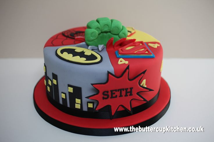 Birthday cake for a Superhero themed party - Batman, Spiderman, Ironman and Superman with a 'Hulk' fist coming up through the middle