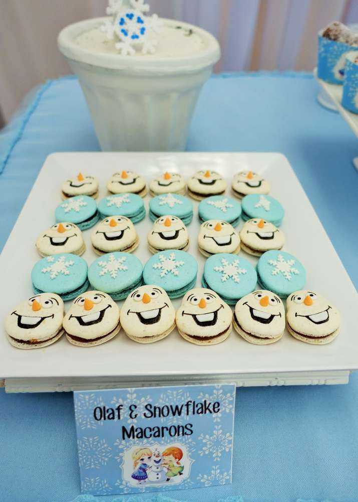 Olaf and snowflake macarons at a Frozen birthday party! See more party planning ideas at CatchMyParty.com!