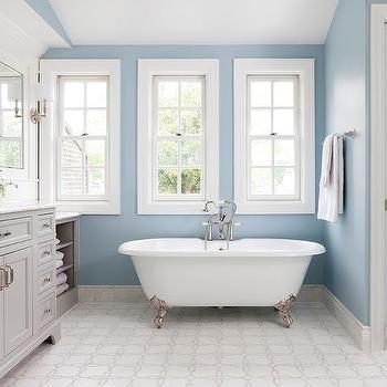 Blue and Gray Bathroom with Silver Claw Foot Bathtub