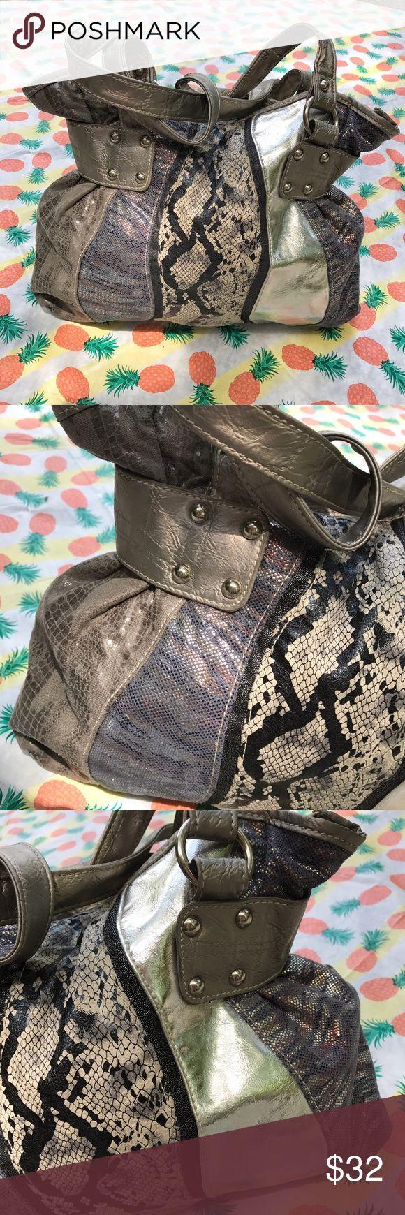 Silver Animal Print Faux Leather Shoulder Bag NWOT | Excellent Condition | Silver Crackled Faux Leather | Mixed Animal Prints | Shoulder Bag | Snap Closure | 2 Open Pockets Inside | 1 Zipper Pocket Inside | Length: 14.5ins | Height: 10ins | Shoulder Drop: 10ins | Chateau Bags Shoulder Bags