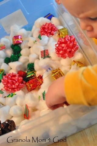 Christmas Sensory Tub- mini cotton balls, glitter pom poms, bows, mini presents, jingle bells