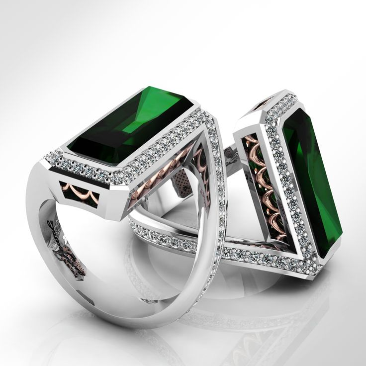 A stunning 18ct White and rose gold Emerald cut green Emerald with a halo of grain set Diamonds and a twisted diamond shank.  A supreme design of elegance and curves by Theo Mosuourakis at www.everjewels.com