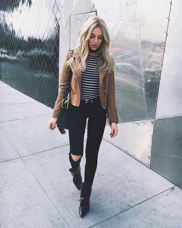 Black jeans, striped top, tan jacket