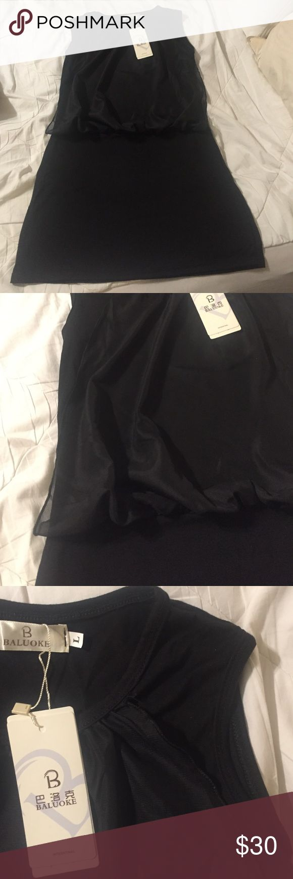 NWT- Cute black dress Very cute little black dress. Sheer lined top that blouses out a bit.  Marked size Large but DEFINITELY runs small! Fits more like a S/M Dresses