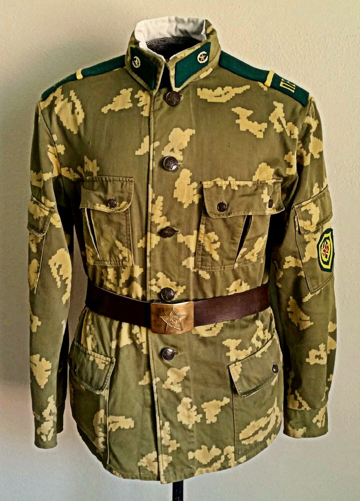 Soviet KGB-PV 'Spetsodezhda' Camouflage Uniform. Introduced during the 1970's, this uniform was a purpose-built field uniform meant to replace the Obr69/73 and KLMK Over-Suit combination. The uniform is cut with a six-pocket jacket, two external pockets on the trousers, knee reinforcements, and is usually seen worn with the same Pogoni i Petlitsi (Shoulder Boards and Collar Tabs) as the Obr69/73. A collar liner is also worn, as well as the standard faux leather belt with brass buckle.