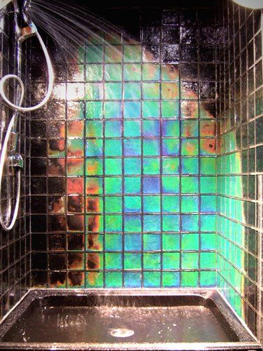 "Moving Color is an innovative technology which takes glass tiles to new heights in terms of interior design. These are temperature sensitive textured glass tiles  which change color with the ambient, body or water temperature. So when someone touches them or if warm water from a shower hits them, the tiles then ""bloom with color""!"