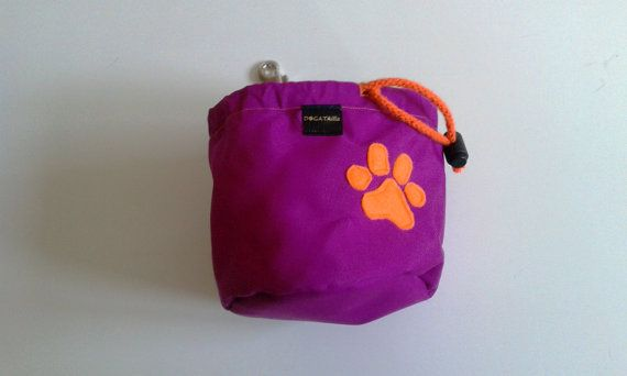 Fuchsia dog treat bag with a paw motif by DoGATAilla on Etsy