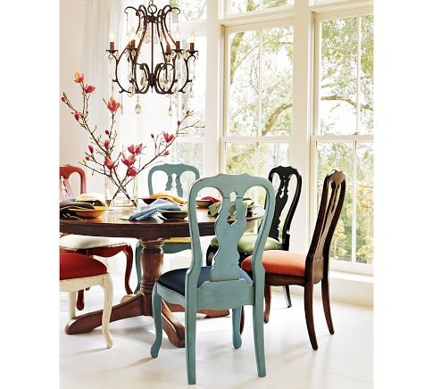 Love the idea of round kitchen table with various colored chairs.  Maybe a white table though....
